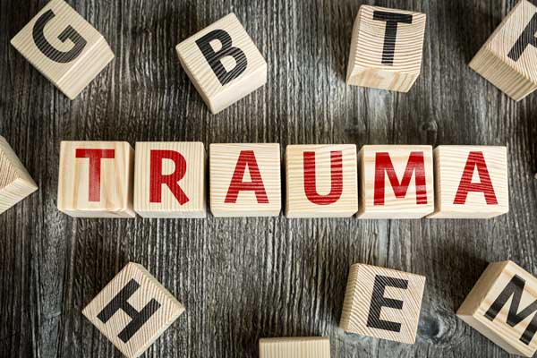 Wooden blocks with letters that spell out TRAUMA