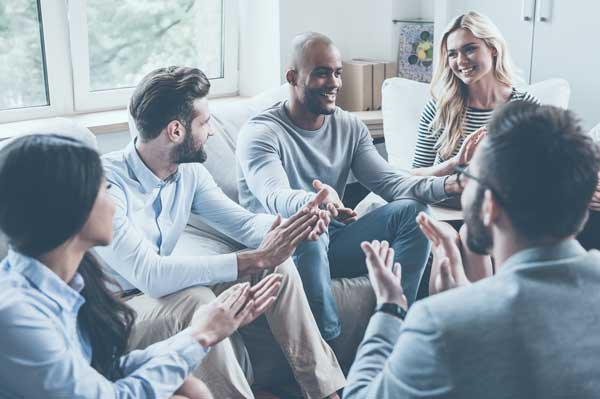 Young men and women in group therapy