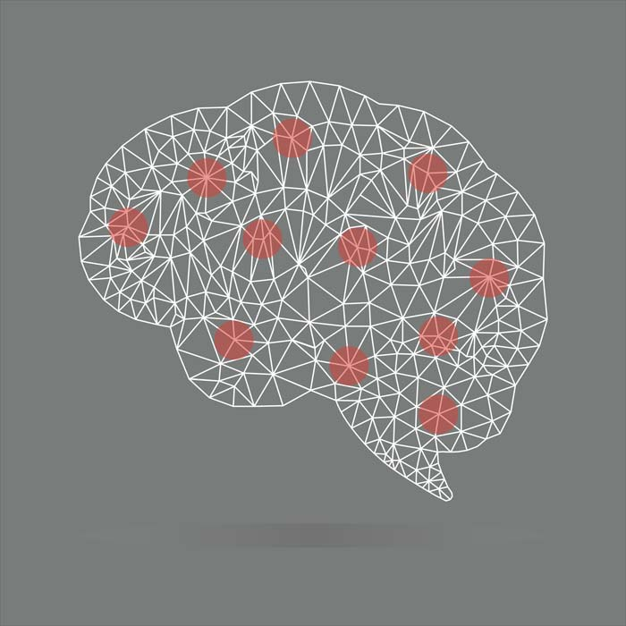 Grey background with brain outline with red spots